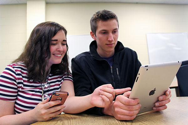 VHCC students looking at a tablet device